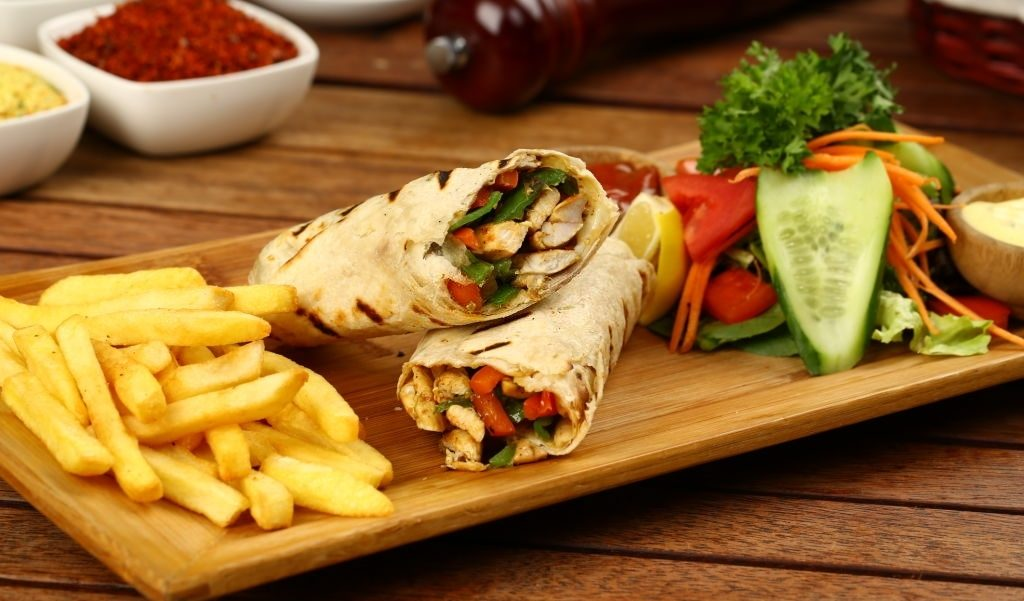 Chicken wrap with fried fries, salad and rice